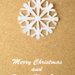 Christmas postcard with true paper snowflake — Stock Photo #33753067