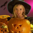 Halloween party with a child holding carved pumpkin — Stock Photo #11879556