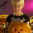 Halloween party with a boy holding carved pumpkin — Stock Photo #11879561