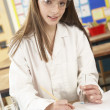 Female Teenage Student In Science Class With Experiment — Stock Photo #11880481