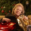 Tired Senior Woman Returning After Christmas Shopping Trip — Stock Photo #11881099
