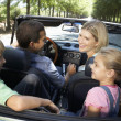 Family in sports car — Stock Photo #11883326