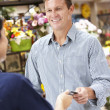 Man serving customer in florist — Stock Photo #11884132