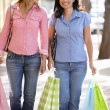 Women carrying shopping — Stock Photo #11884219
