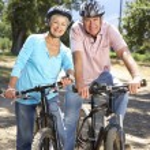 Senior couple on country bike ride — Stock Photo #11885919