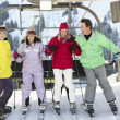 Teenage Family Getting Off chair Lift On Ski Holiday In Mountain — Stock Photo #11892660