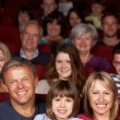 Family Watching Film In Cinema — Stock Photo #24439907