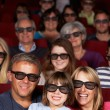 Family Watching 3D Film In Cinema — Foto Stock