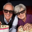 Senior Couple Watching 3D Film In Cinema - Stock fotografie