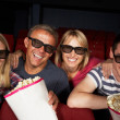 Teenage Family Watching Film In Cinema — Stockfoto