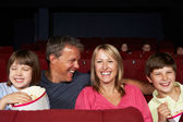 Family Watching Film In Cinema — Stock Photo