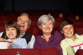 Grandparents Watching Film In Cinema With Grandchildren — Stock Photo