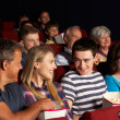 Teenage Family Watching Film In Cinema — Stock Photo