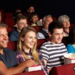 Teenage Family Watching Film In Cinema — Stock Photo #24440091