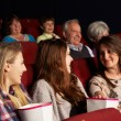 Group Of Teenage Girls Watching Film In Cinema — Stock Photo
