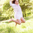 Young Girl Jumping In Summer Field — Stock Photo