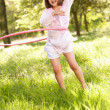 Young Girl Walking Playing With Hula Hoop In Summer Field — Stock Photo