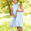Young Girl Walking Through Summer Field Holding Sunflower — Stock Photo