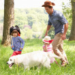Father Playing Exciting Adventure Game With Children And Dog In  — Stockfoto