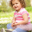 Young Girl In Summer Dress Sitting In Field — Stock Photo