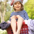 Young Boy Sitting In Laundry Basket — Stock Photo
