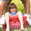 Father Carrying Son Sitting In Laundry Basket — Stock Photo #24441453