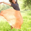Woman Jumping In Summer Field - Stock Photo
