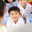Teacher Reading To Students In Chinese School Classroom — Foto de stock #24441947