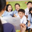 Teacher Showing Painting To Students In Chinese School Classroom — Stock Photo