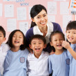 portait of teacher and students in chinese school classroom — Stock Photo