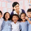 Stock Photo: Portait Of Teacher And Students In Chinese School Classroom