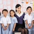 Foto de Stock  : Portait Of Teacher And Students In Chinese School Classroom