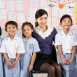 Стоковое фото: Portait Of Teacher And Students In Chinese School Classroom