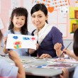 Stock Photo: Teacher Helping Students During Art Class In Chinese School Clas