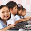 Female Pupil Using Keyboard During Computer Class In Chinese Sch — Foto Stock