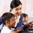 Teacher Helping Student During Computer Class In Chinese School  — Stock Photo
