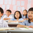 Group Of Students Working At Desks In Chinese School Classroom — Foto Stock