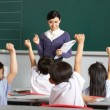 Teacher With Students In Chinese School Classroom — Stock Photo