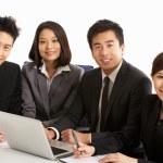 Studio Shot Of Chinese Businesspeople Having Meeting — Stock Photo