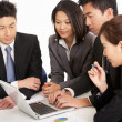 Studio Shot Of Chinese Businesspeople Having Meeting - Stock Photo