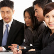 Studio Shot Of Chinese Businesspeople Having Meeting - Foto Stock