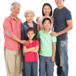 Stock Photo: Full Length Studio Shot Of Multi-Generation Chinese Family