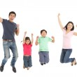 Studio Shot Of Chinese Family Jumping In Air — Stock Photo #24443491