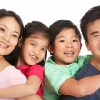 Foto Stock: Studio Shot Of Chinese Family