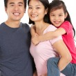 Studio Shot Of Chinese Family — Foto de stock #24443601