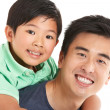 Stock Photo: Studio Shot Of Chinese Father And Son