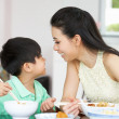 Chinese Mother And Son Sitting At Home Eating A Meal — Stock Photo #24444139