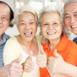 Group Of Senior Chinese Friends Relaxing On Sofa At Home — Stock Photo #24444213