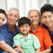 Royalty-Free Stock Photo: Portrait Of Multi-Generation Chinese Family Relaxing At Home Tog