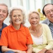 Stock Photo: Group Of Senior Chinese Friends Relaxing On Sofa At Home